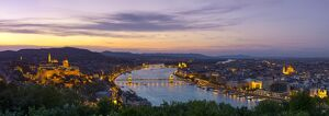 Elevated view over Budapest & the River Danube illuminated at sunset, Budapest, Hungary