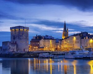 France, poitou-Charentes, La Rochelle, town reflected in harbour at dusk