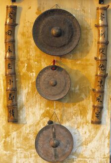 Gongs hanging on a wall