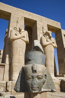 Headless statues of Ramses II line the courtyard at