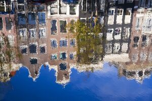 Holland, Amsterdam, traditional Gabled houses reflected in canal