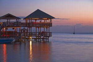 Honduras, Bay Islands, Roatan, West End, Fosters bar and restaurant at sunset