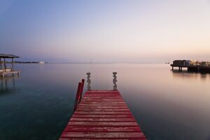 Honduras, Bay Islands, Utila, Red jetty at sunset