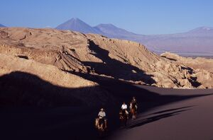Horse riding amongst the wind-eroded peaks and lunar