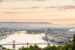 Hungary, Central Hungary, Budapest. Sunrise over Budapest and the Danube from Gellert