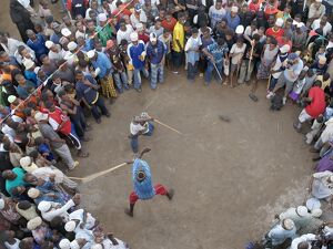 lamu crowds watch stick fight waterfront lamu