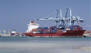 A large container vessel discharges its cargo at the port of Djibouti