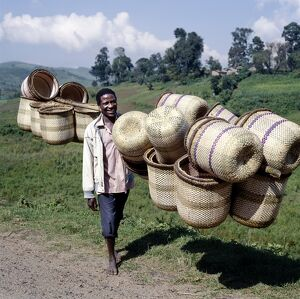 A man carries traditional split-bamboo baskets to sell