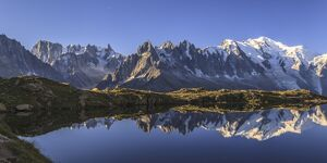 The Mont Blanc mountain range reflected in the waters of Lac de Chesery at sunrise