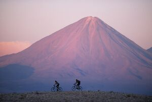 Mountain biking in the Atacama Desert against a backdrop