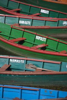 Nepal, Pokhara, Colourful canoes on Phewa Lake