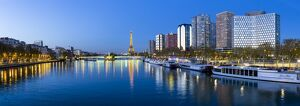 Night view of River Seine with high-rise buildings on the Left Bank, and Eiffel Tower
