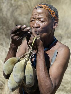 A N!!S hunter-gatherer lights his pipe to relax having