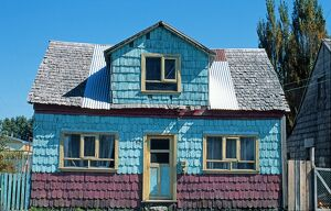Painted shingle covered house
