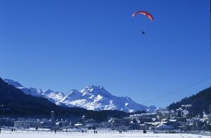 A paraglider comes into land on the frozen