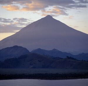 Photographed from Lake Mutanda at sunrise, Mount Muhavura looms like a huge pyramid