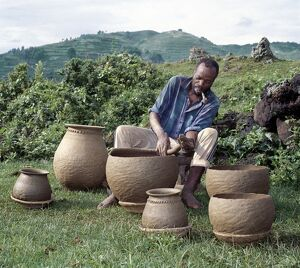 A potter fashions cooking pots by the coil method