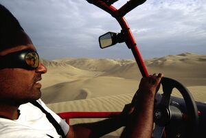 Riding in the front seat of a dune buggy