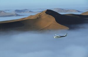 Safari flights over red sand dunes of Sossusvlei with