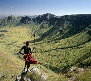 A Samburu warrior looks out across the eastern scarp