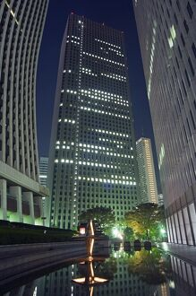 Shinjuku skyscrapers and city buildings at night