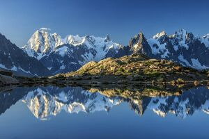 Snowy peaks of Dent Du Geant and Grandes Jorasses are reflected in Lac Blanc, Haute Savoie