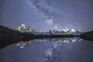 Starry sky over Mont Blanc range seen from Lac de Chesery. Haute Savoie. France Europe