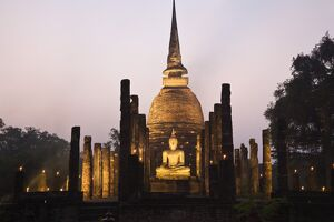 Thailand, Sukhothai, Sukhothai. Ruins of Wat Sa Si (also known as Sacred Pond Monastery) lit during the festival of Loy Krathong in the Sukhothai
