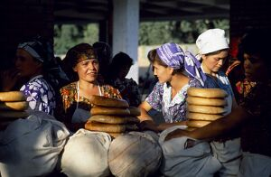 Uzbek women at a bread stall in the market