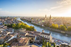 Verona, Veneto, Italy. High angle view of the old town and the Adige river at sunset