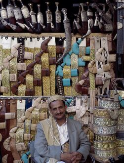 Yemeni trader sells traditional daggers at his stall