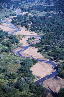 Zambia. Aerial view of the weaving course of a tributary of the Zambezi River.