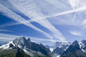 Airplane vapour trails over the Mer du glace Chamonix France Cause and affect As