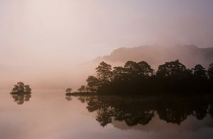 Rydal water and autumn mist in the Lake district UK
