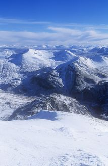 The view of the Mamore mountains from the summit of Ben Nevis in winter, Scotland, UK.