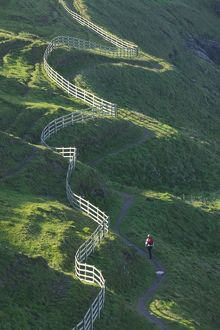 A winding fence and the South West Coast Path near Port Isaac in Cornwall UK