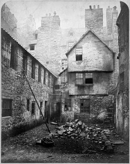 View of houses on East side of College Wynd, Edinburgh, prior to demolition. Date: 1871