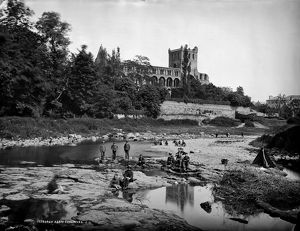 View looking across river Jed to Jedburgh Abbey. Date: c1887