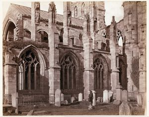 View of Melrose Abbey. The man in the image may be the photographer William Donaldson