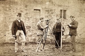 View of four surveyors outside unidentified building. Date: c1870