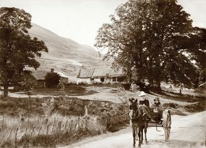 View of thatched buildings at Lochearnhead. Date: 1892