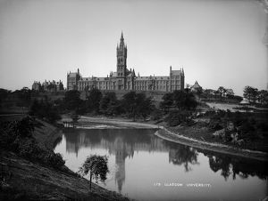 View of the University of Glasgow across the river Kelvin. Date: c1900