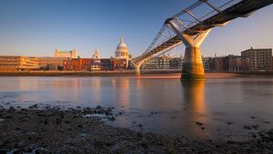 UK, England, London, St. Paul's Cathedral and Millennium Bridge over River Thames