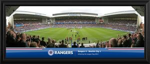 Club legend Sandy Jardine walks out to a packed Ibrox and unfurls the 2012/13 SFL