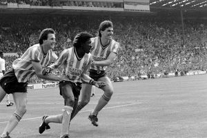Coventry City's Dave Bennett (c) celebrates with teammates Keith Houchen (l)