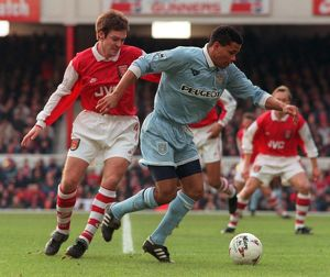 Coventry's John Salako holds off Adrian Clark during Premiership match at Highbury