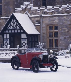 1930 MG M type in snow at Palace House, Beaulieu
