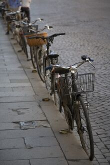 Bicycles parked at curb, Ferrara, Emilia Romagne, Italy