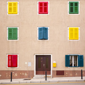 architecture/europe croatia vrsar building colorful shutters