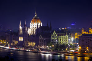 Europe, Hungary, Budapest. Parliament Building on Danube River at night. Credit as